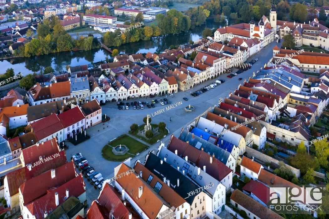 Stock Photo: Aerial view before sunrise of the town of Telc with its castle, renaissance architecture, square and ponds in the Czech Republic.