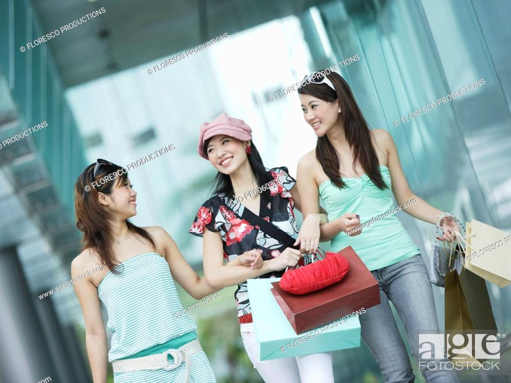 Stock Photo: Three women outdoors with shopping bags.