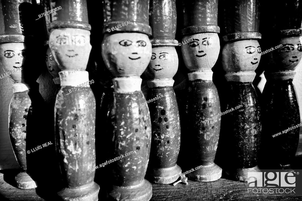 Stock Photo: Group of wooden dolls of a child vintage game looking at the camera.