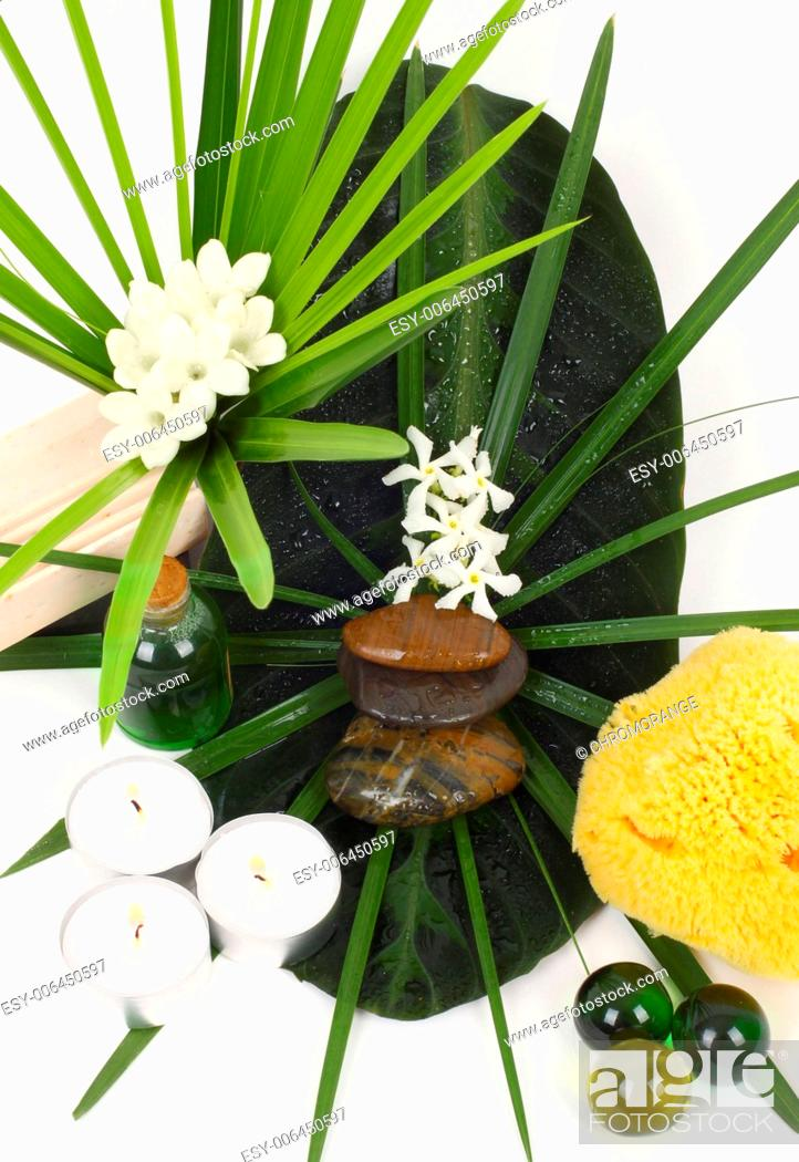 Stock Photo: Accessories for spa with flowers of jasmine on white background.