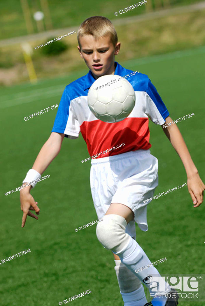 Stock Photo: Close-up of a soccer player playing with a soccer ball.