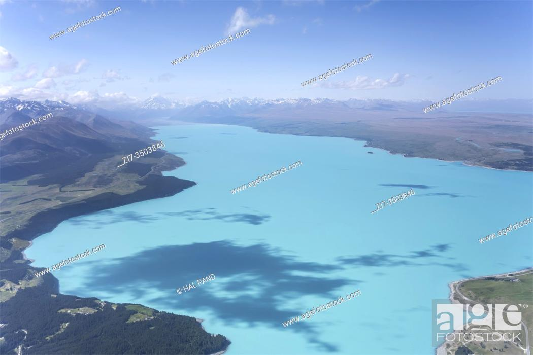 Stock Photo: aerial, from a glider, of clear blue Pukaki lake, shot in bright spring light from south, Canterbury, South Island, New Zealand.