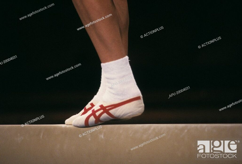 Stock Photo: gymnast performing on beam.
