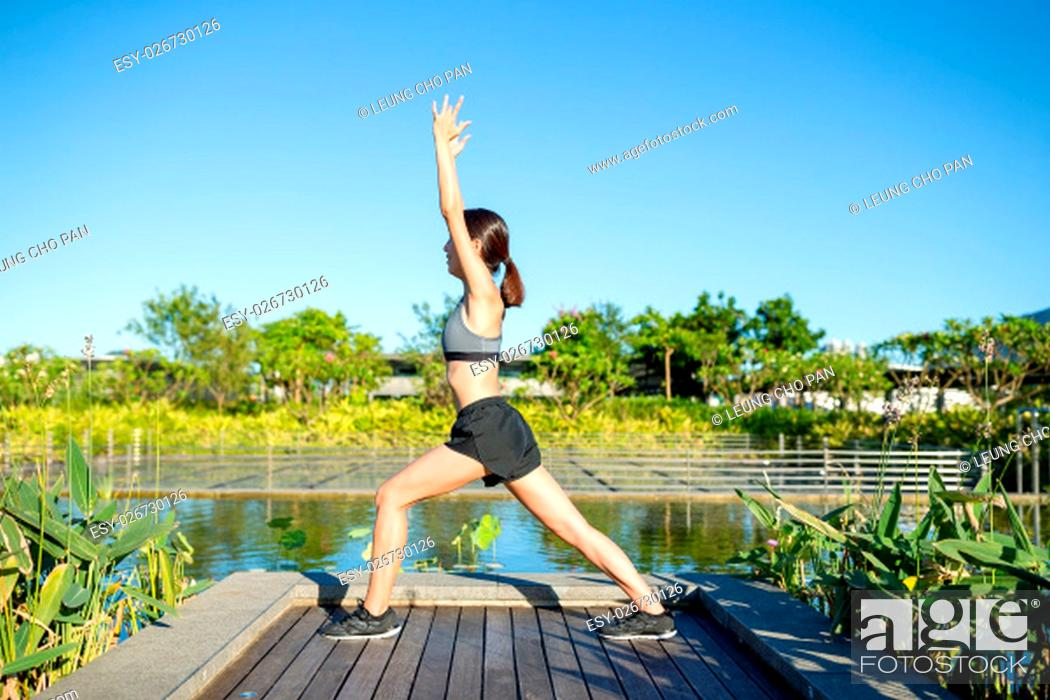 Stock Photo: Young woman is practicing yoga.