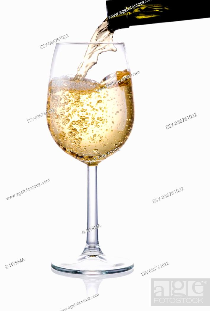 Stock Photo: Pouring a glass of white wine isolated on a white background.