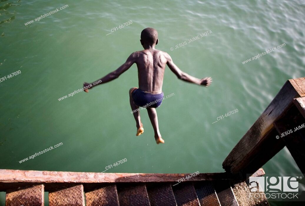 Stock Photo: Boy diving. Gambia.