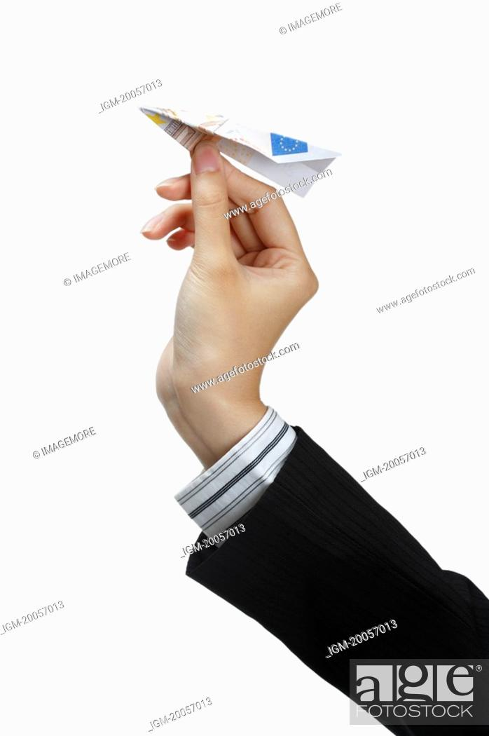 Stock Photo: Human hand playing with paper airplane.