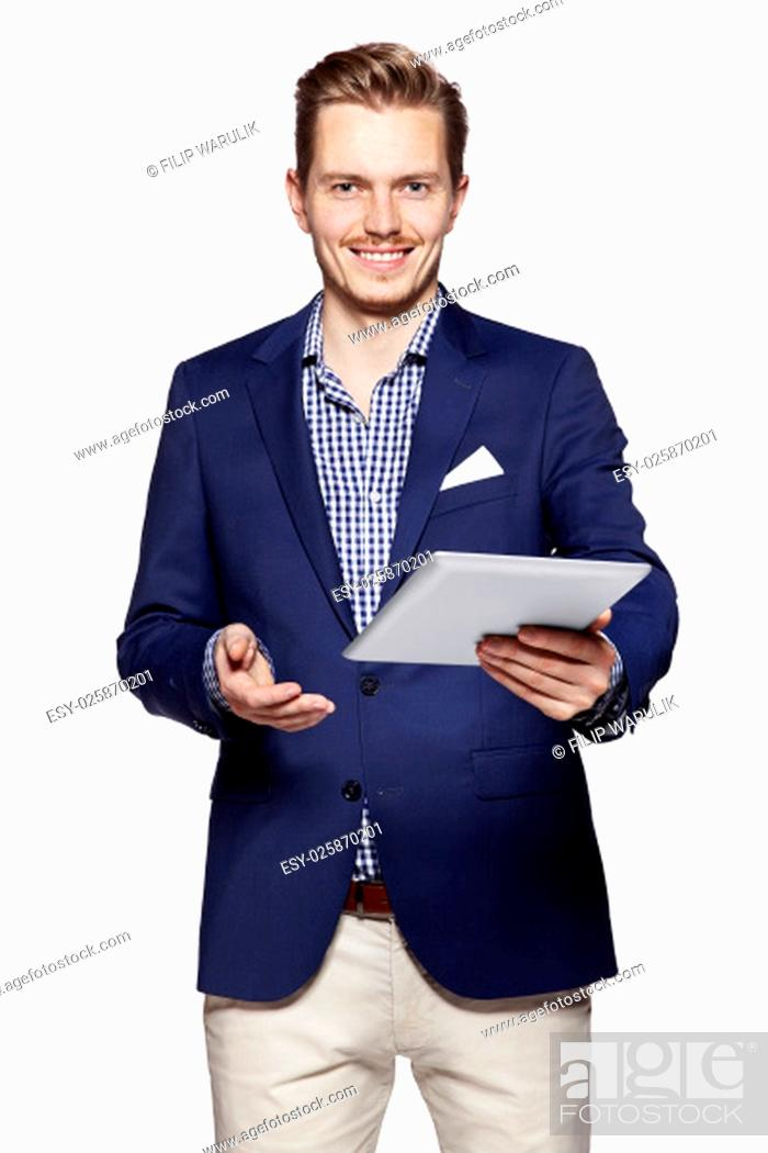 Stock Photo: Studio shot of a happy young man giving a digital tablet. Isolated on white background.