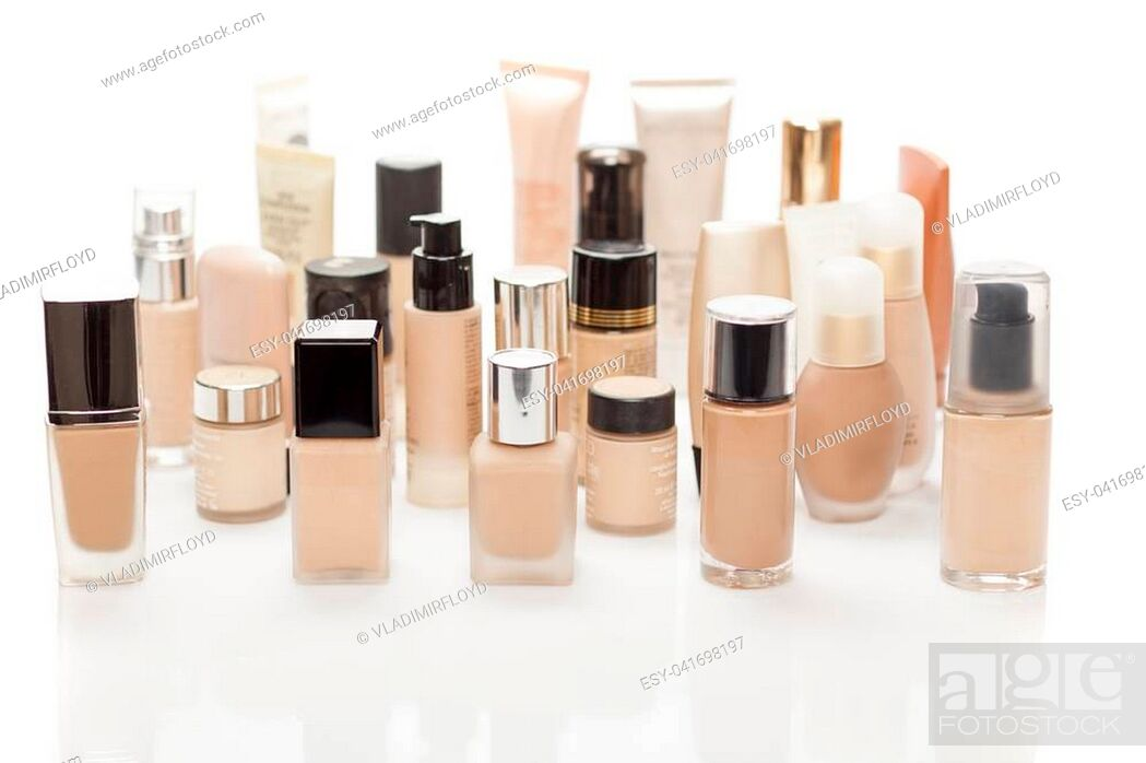 Stock Photo: different bottles with liquid foundation on white background.