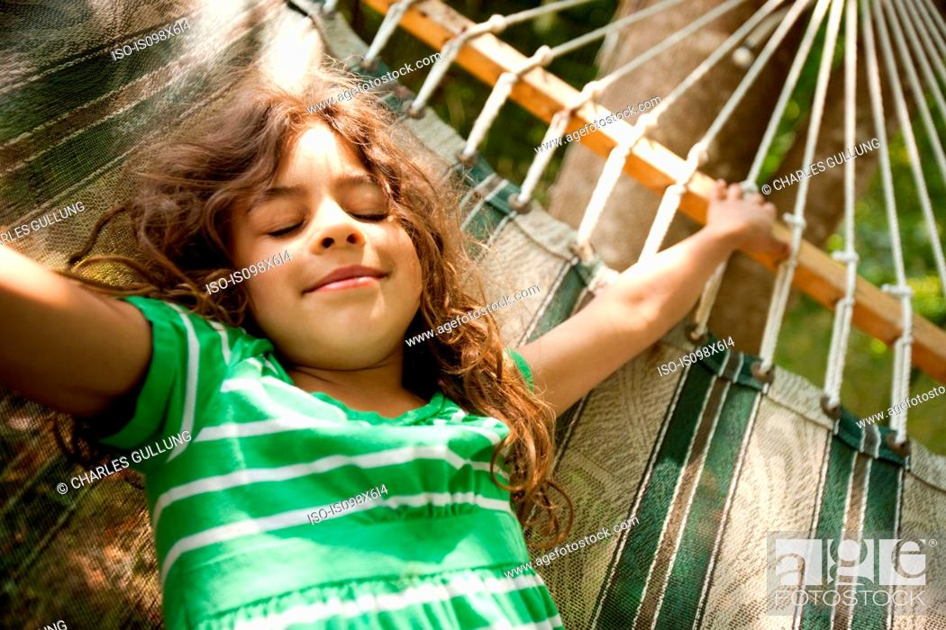 Stock Photo: Young girl lying on hammock.