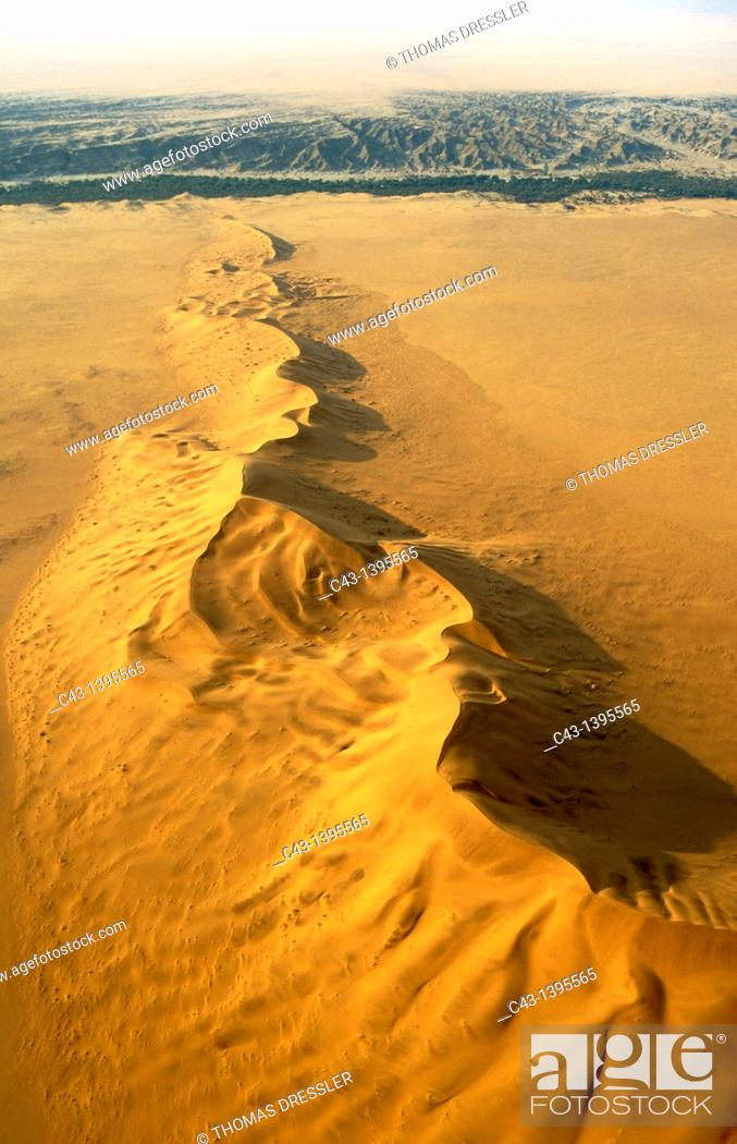 Stock Photo: Namibia - The green belt of the dry Kuiseb riverbed in the background is forming the northern boundary of the expanse of dunes of the southern Namib Desert.