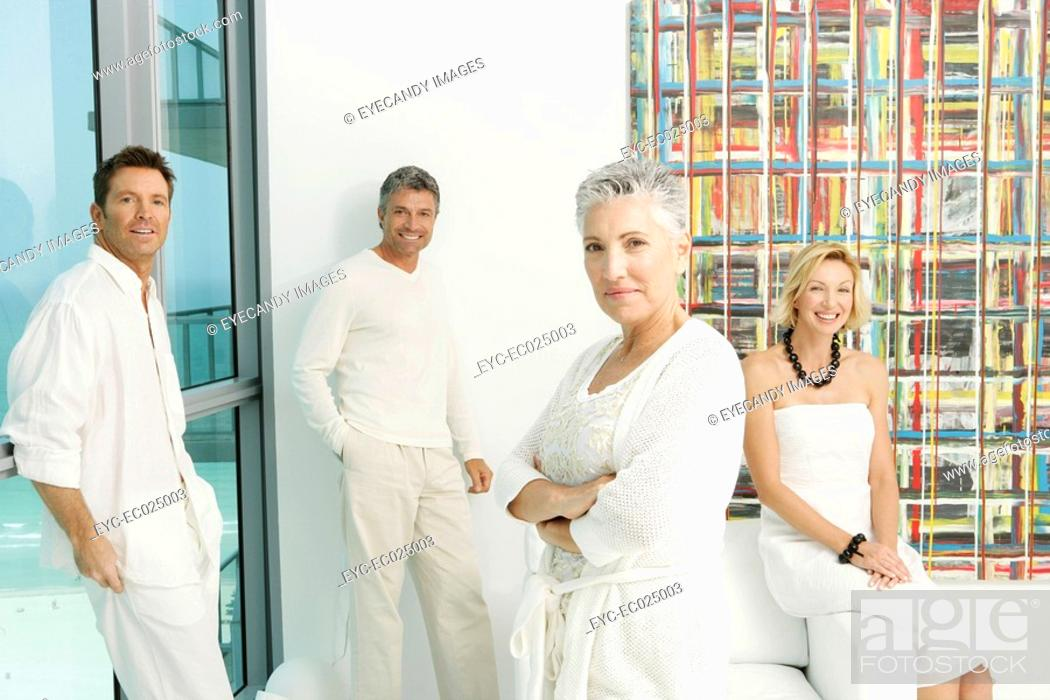 Stock Photo: View of four people looking at the camera.