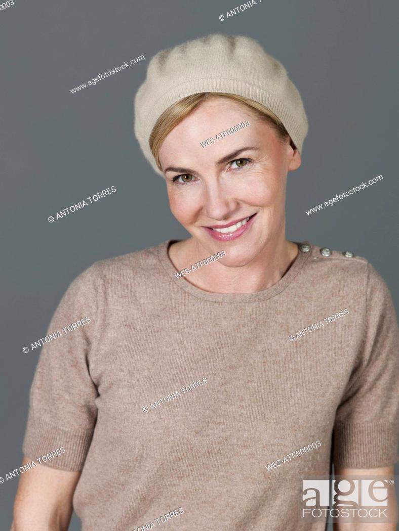 Stock Photo: Mature woman smiling, portrait.