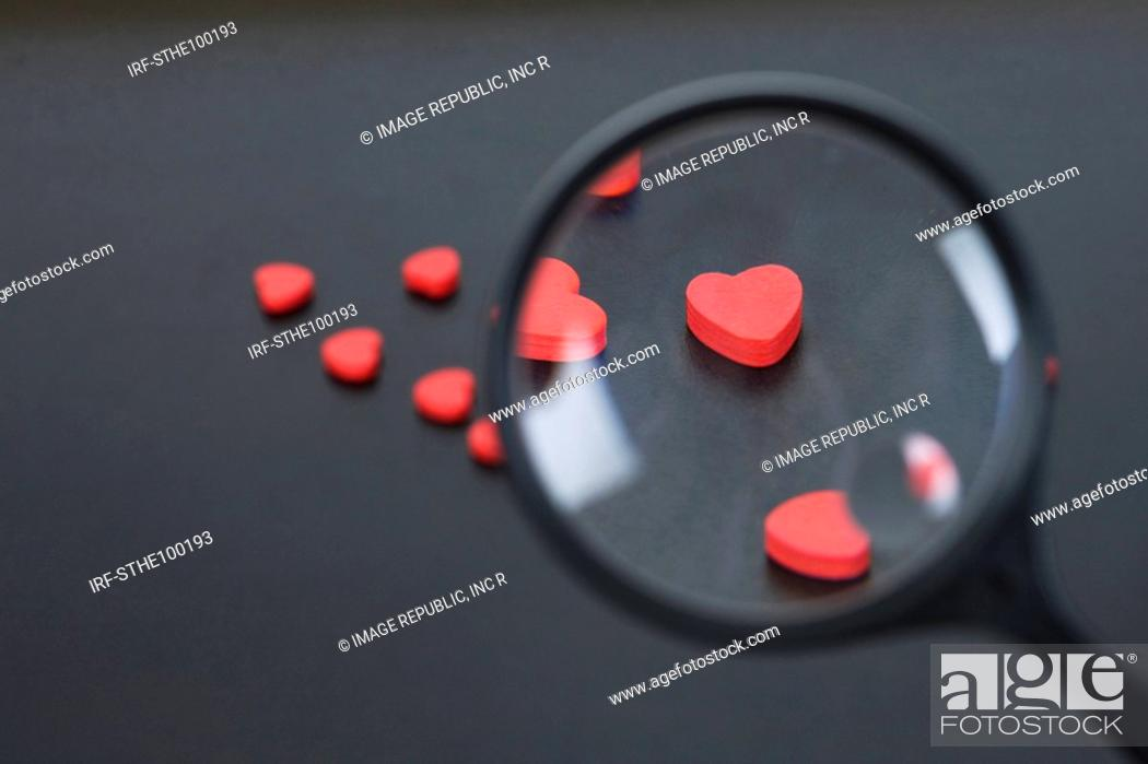 Stock Photo: heart shapes through a magnifying glass.
