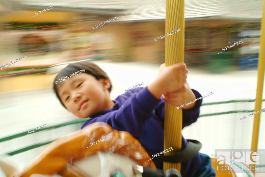 Stock Photo: 5 year old chinese girl at fair.