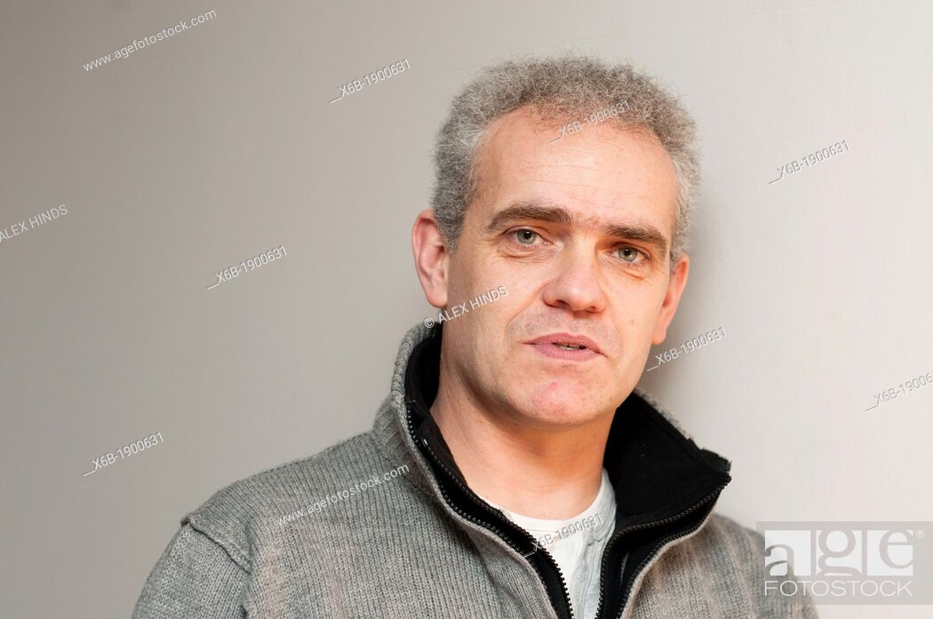 Stock Photo: Casual portrait of middle aged man with grey hair.