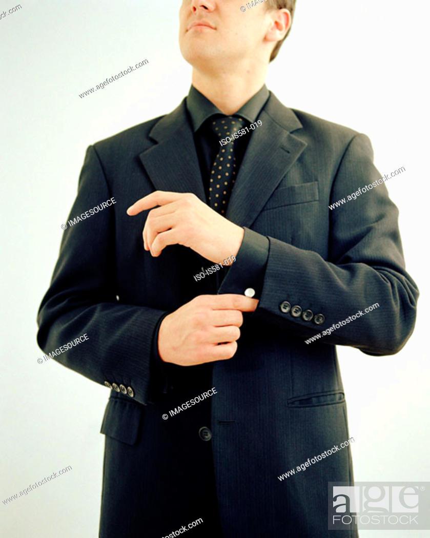 Stock Photo: Businessman adjusting sleeve.