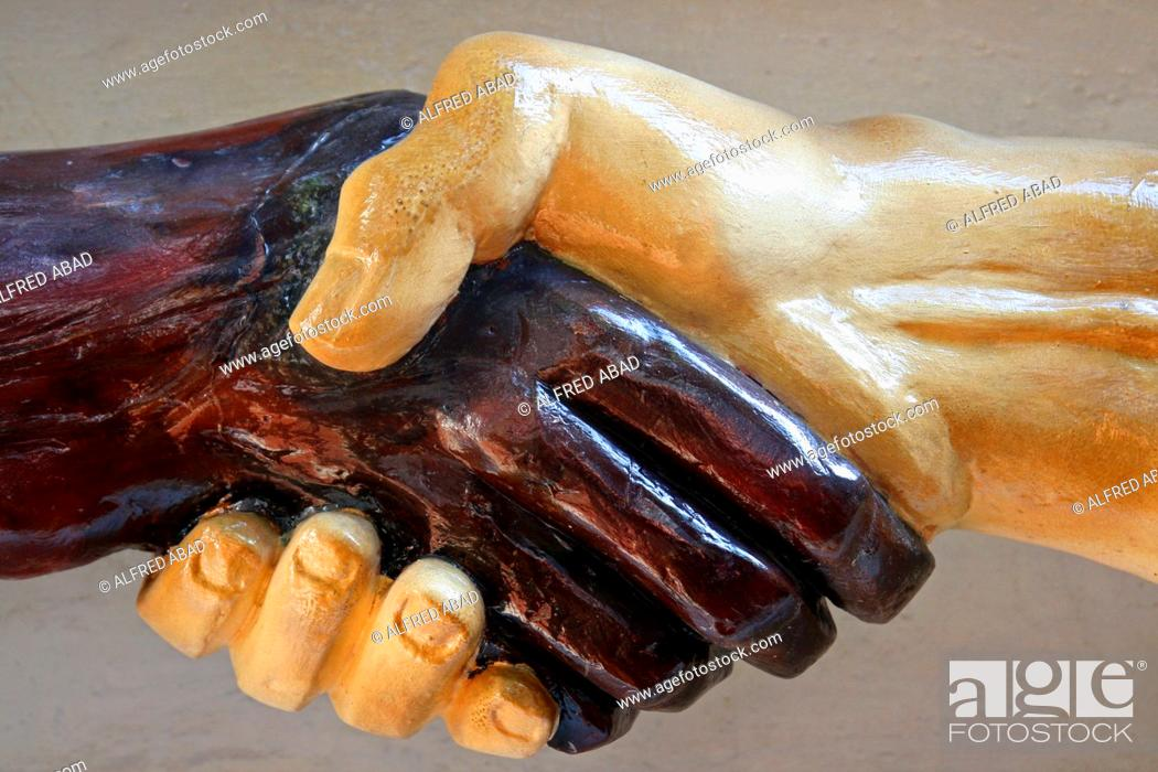 Stock Photo: sculpture of hands intertwined in the Serenissima Grand National Lodge, Cartagena de Indias, Colombia.