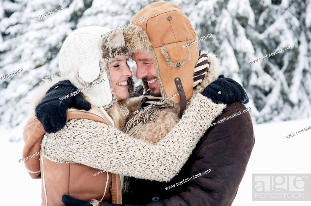 Stock Photo: Austria, Salzburg County, Couple embracing each other, smiling.