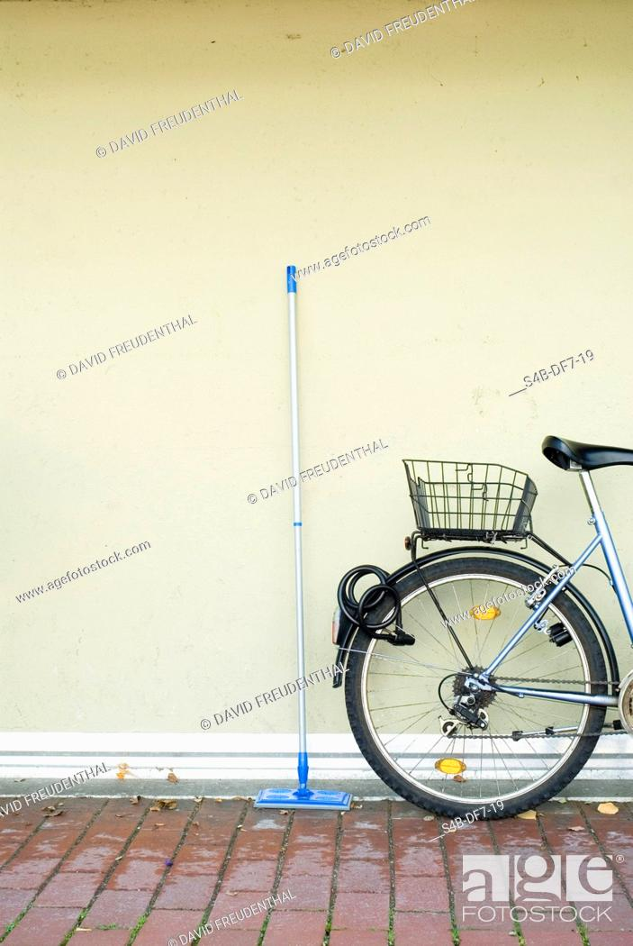 Stock Photo: Swab next to a bicycle.