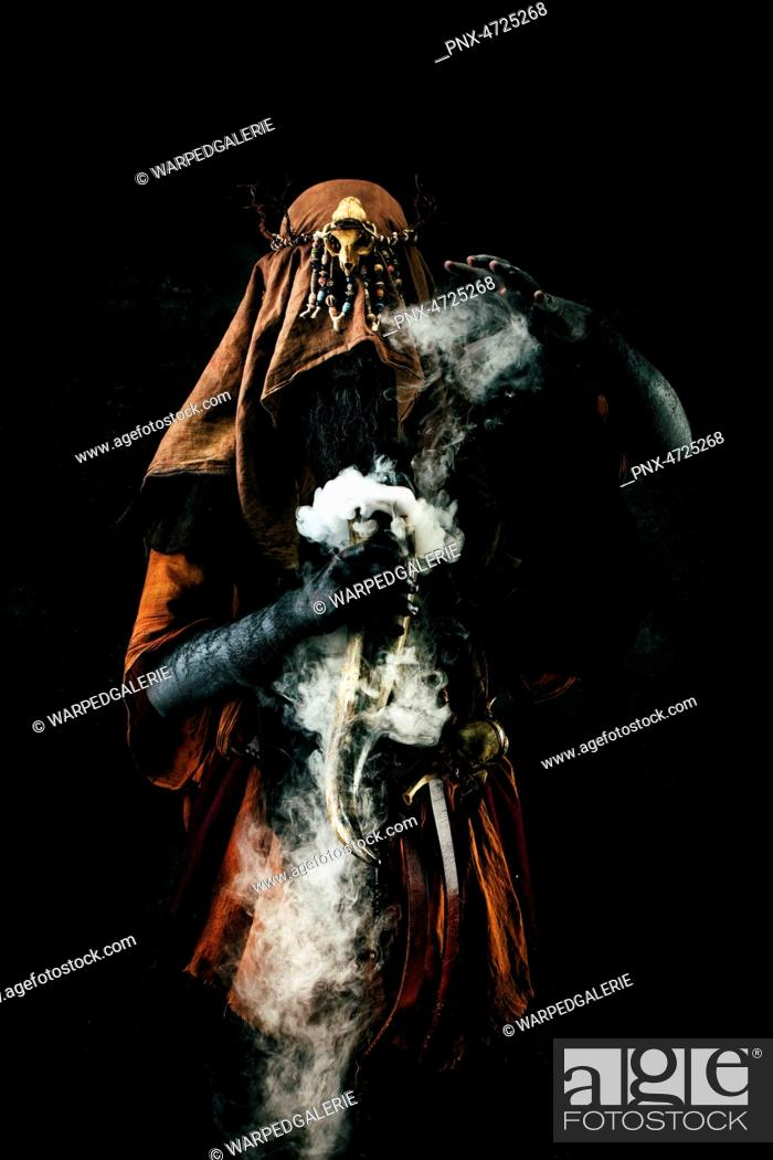 Stock Photo: Portrait of a shaman holding a steaming horn.
