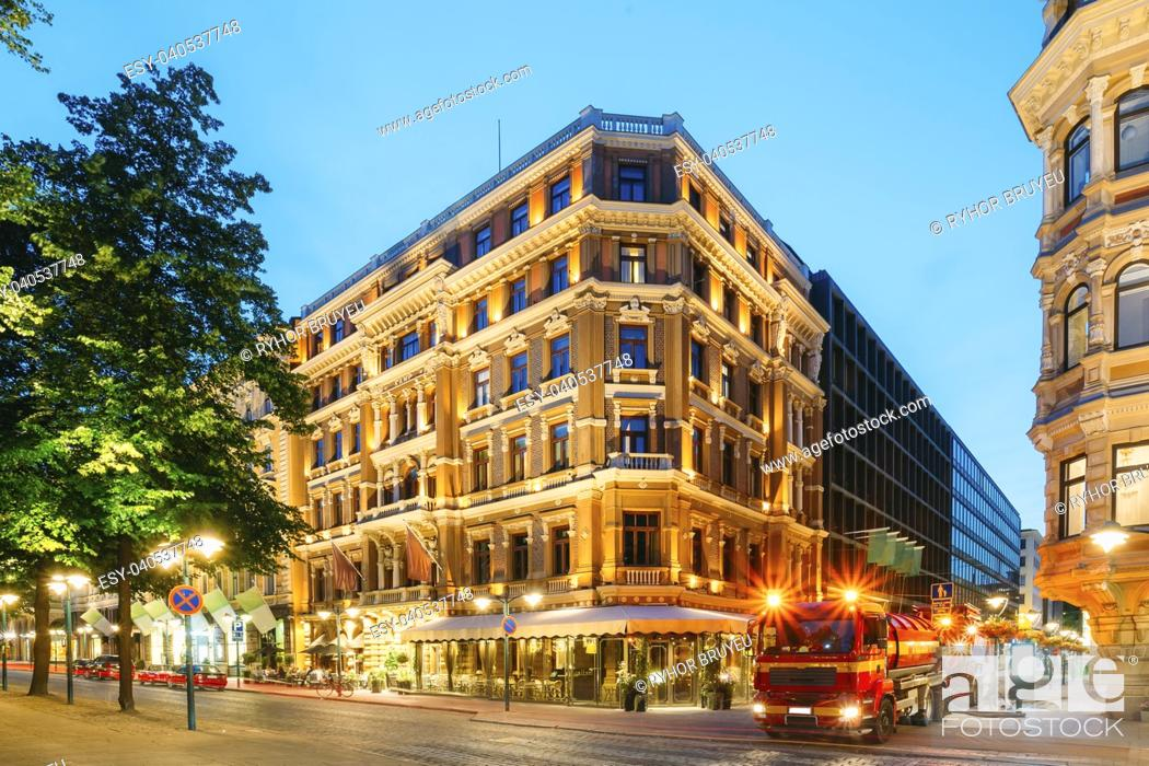 Stock Photo: Helsinki, Finland. Service Machine Car Performs Drainage Work On Corner Of Pohjoisesplanadi And Kluuvikatu Streets. Night View Of Pohjoisesplanadi Str In Kluuvi.