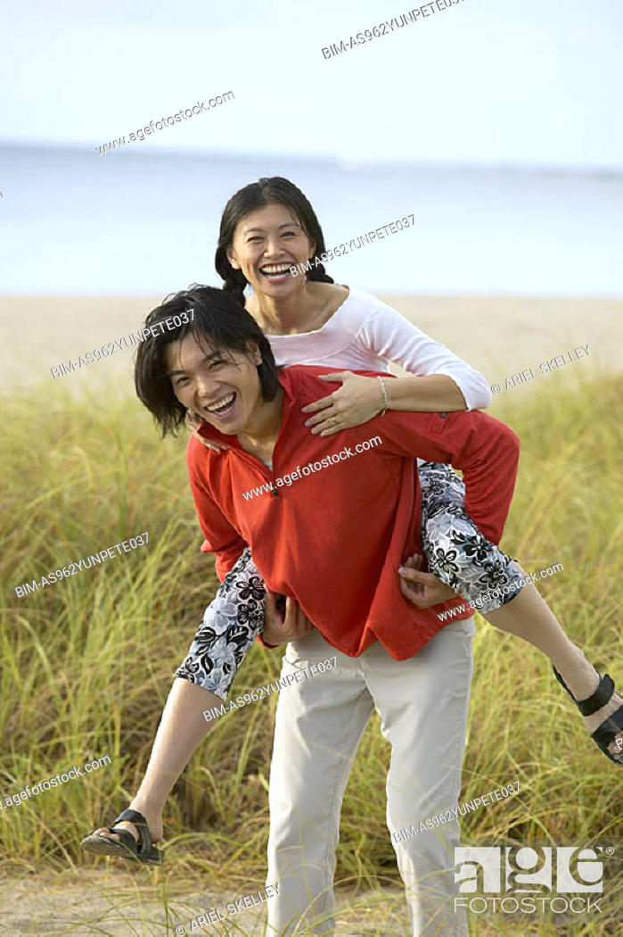 Stock Photo: Couple playing on the beach.