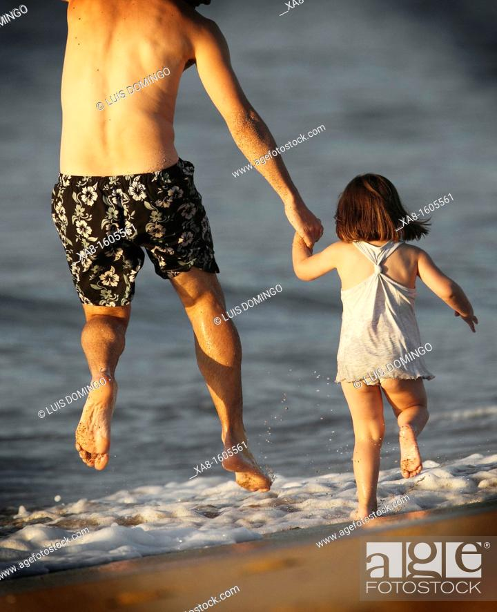 Stock Photo: FATHER AND DAUGHTER PLAYING ON THE BEACH IN GALICIA SPAIN VALDOVIÑO.