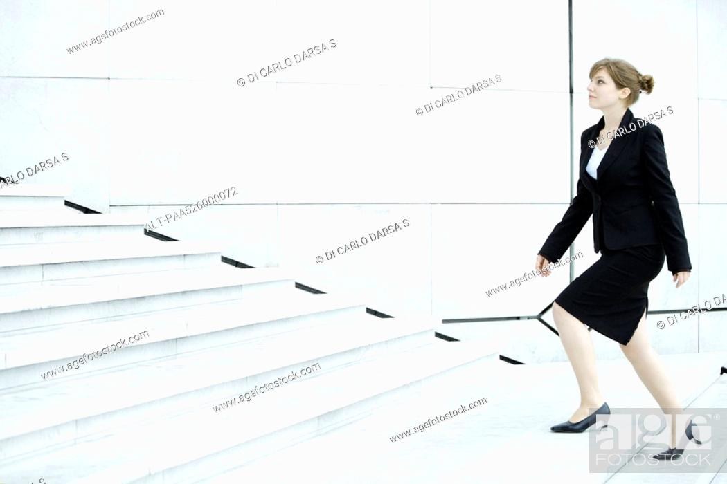 Stock Photo: Businesswoman ascending steps.