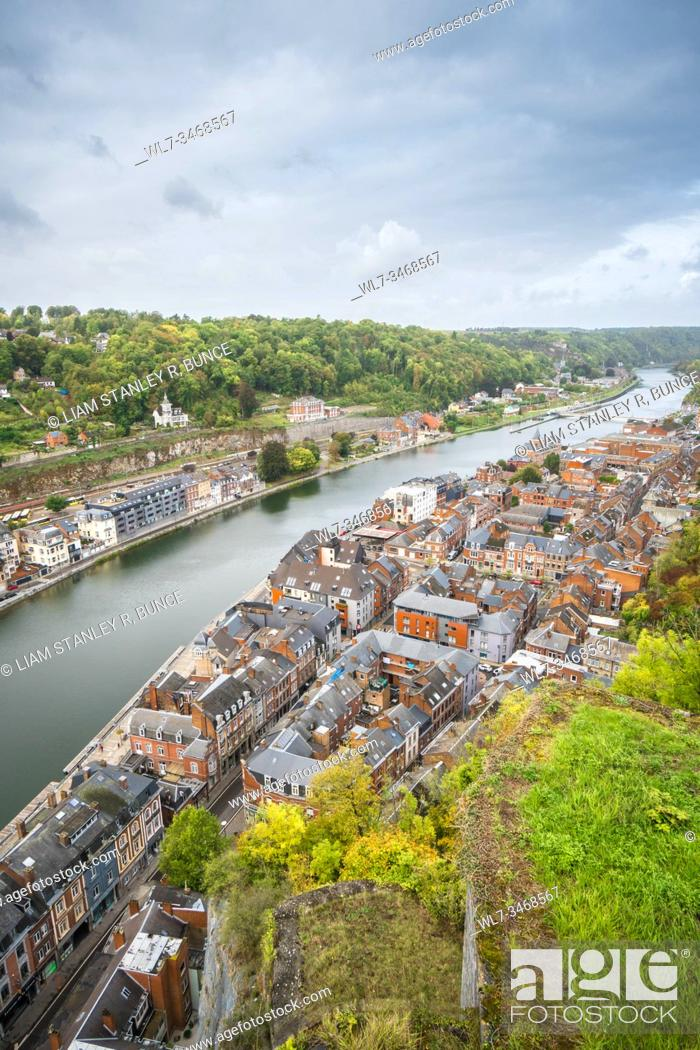 Stock Photo: The river Meuse meandering it's way though Dinant, Belguim. October 2019.
