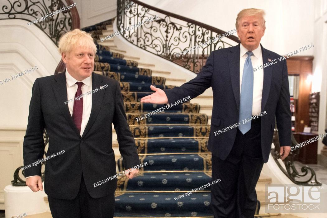 Stock Photo: August 25, 2019, Biarritz, France: U.S. President DONALD TRUMP, right, and Britain's Prime Minister BORIS JOHNSON arrive for a bilateral meeting during the G7.