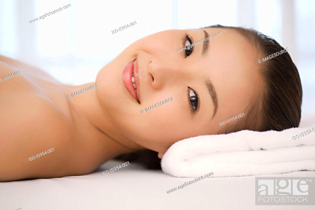 Stock Photo: Face of young woman lying down.
