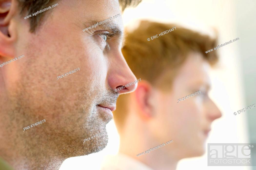 Stock Photo: Close-up of a man with another man in the background.
