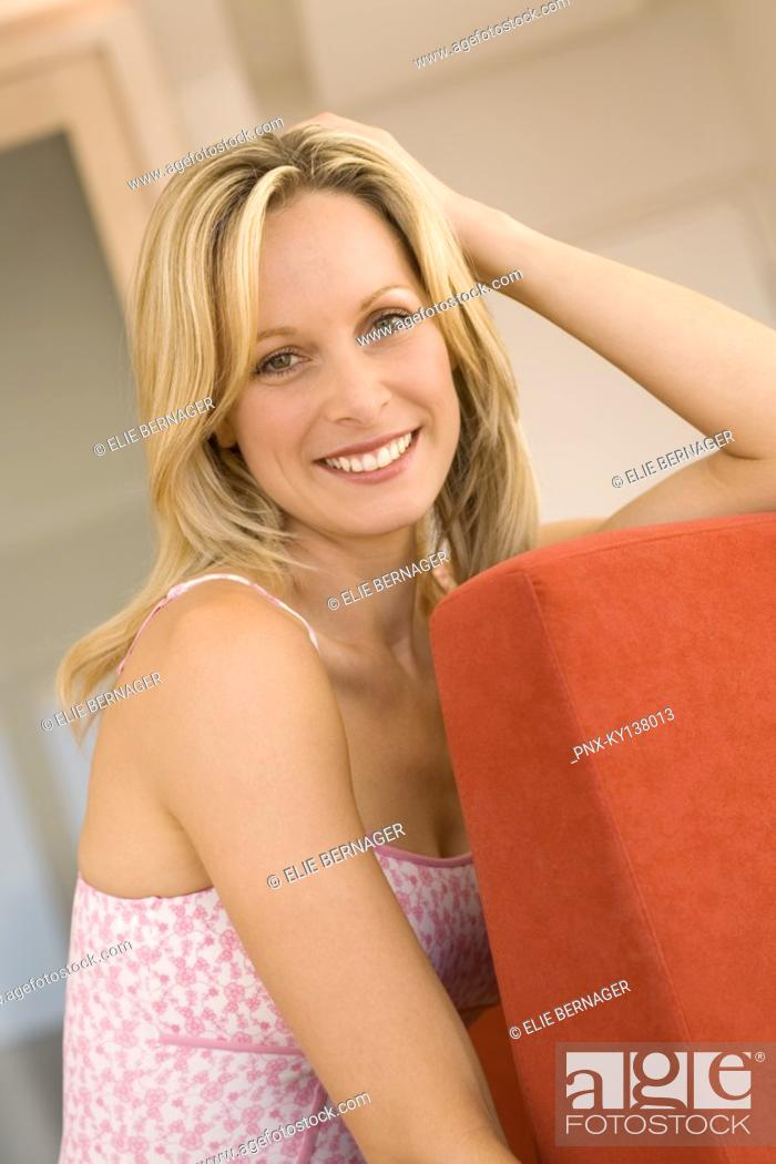 Stock Photo: Young woman smiling for the camera.