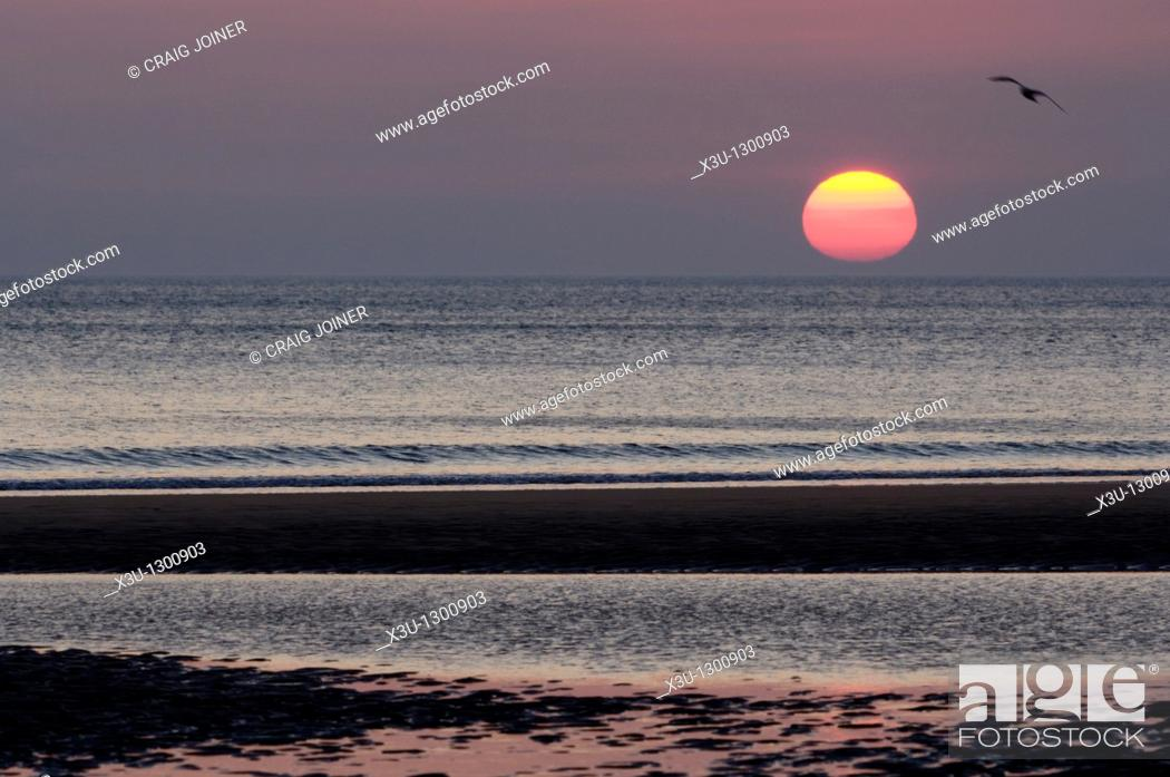 Stock Photo: Sunset over Bude Bay from Sandymouth Beach, Cornwall, England, United Kingdom.