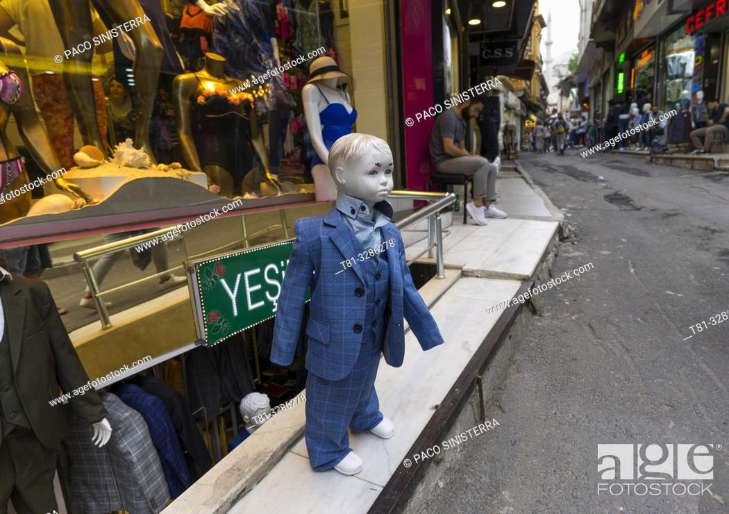 Stock Photo: Boy mannequin wearing a suit in a clothing store. Istanbul, Turkey.
