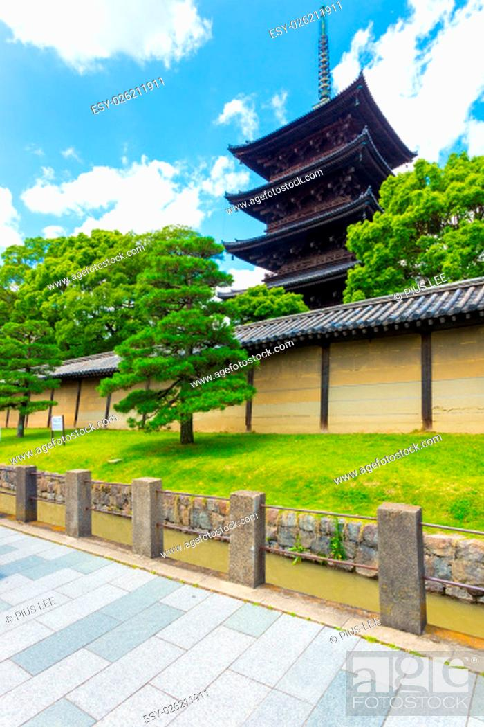Stock Photo: Toji five story pagoda seen from outside its wall on a clear, sunny, blue sky day in Kyoto, Japan. Vertical.