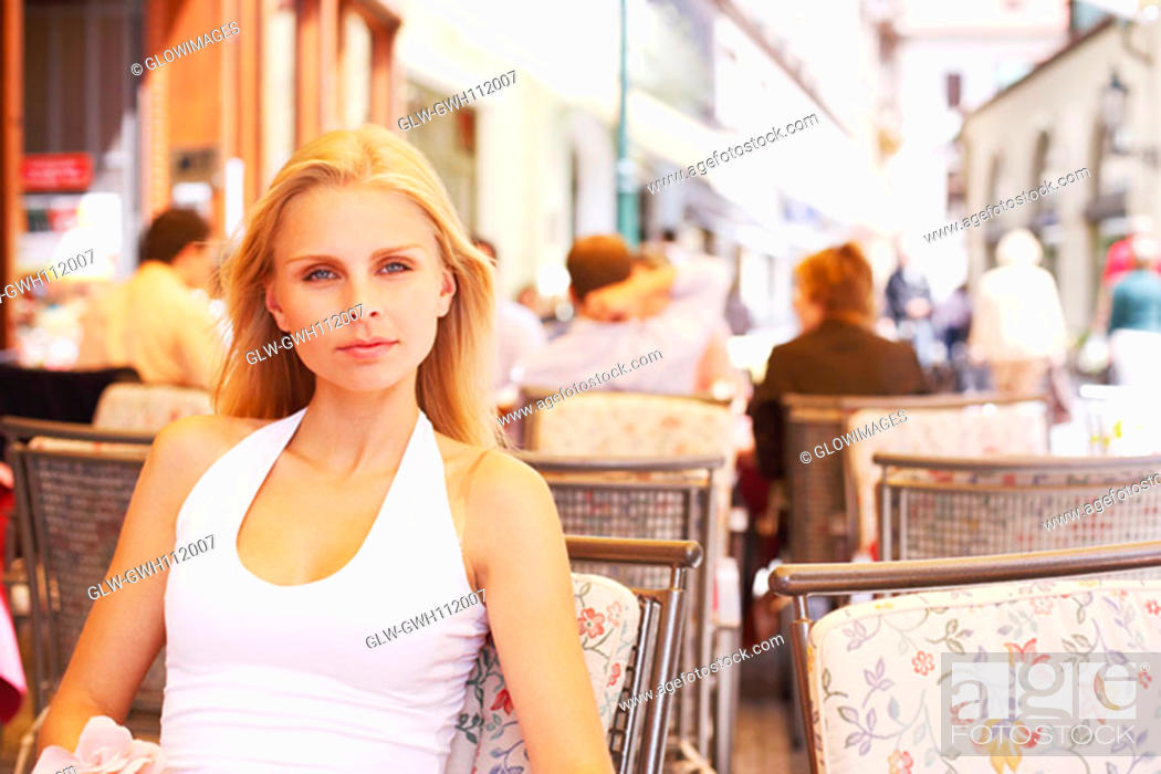 Stock Photo: Portrait of a young woman sitting in a restaurant.