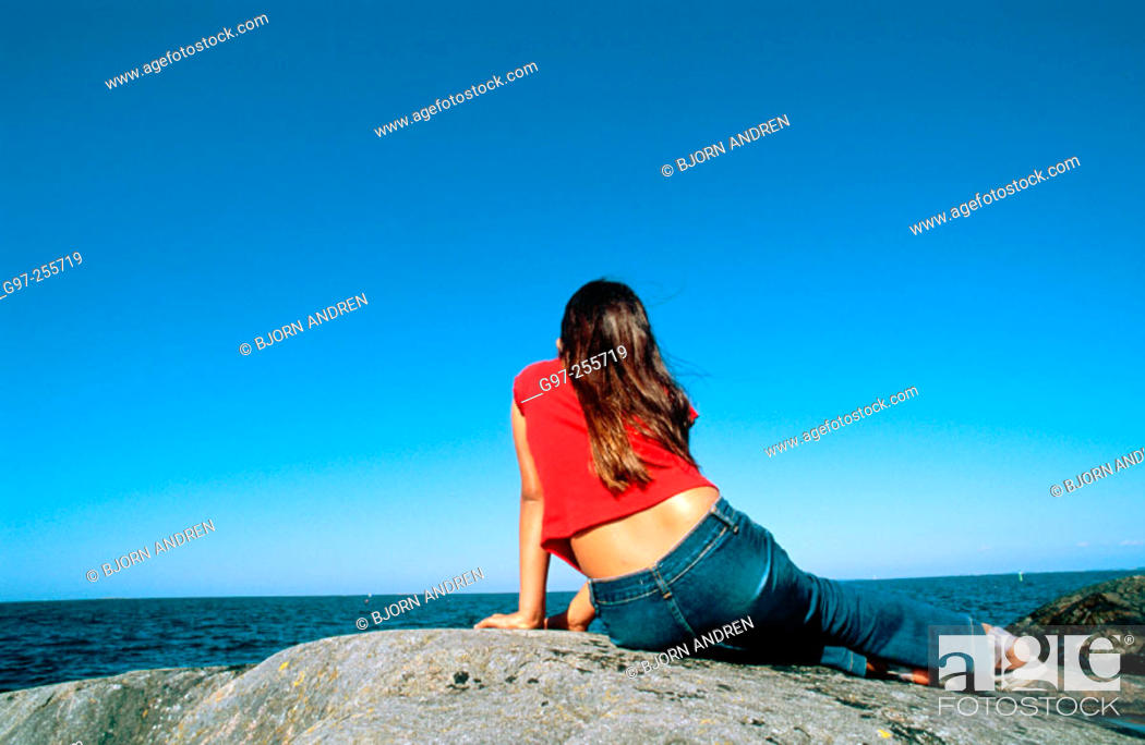 Stock Photo: Girl looking at the sea.
