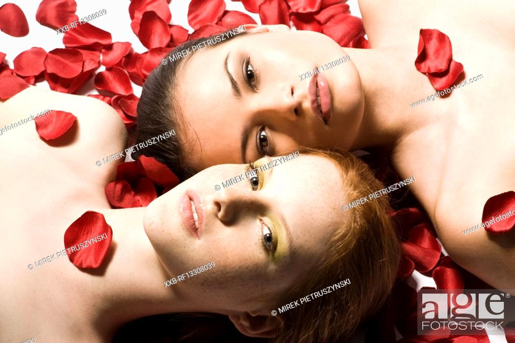 Stock Photo: two women in roses patals.