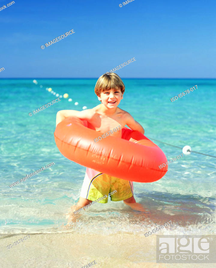 Stock Photo: Boy with an inflatable ring.