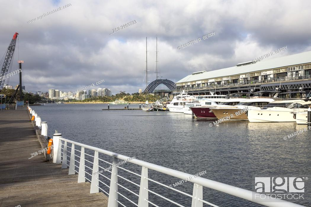 Stock Photo: Jones Bay Wharf in Pyrmont Sydney city centre, contains luxury boats in a marina and commercial office space.It has historic significance to Sydney, Australia.