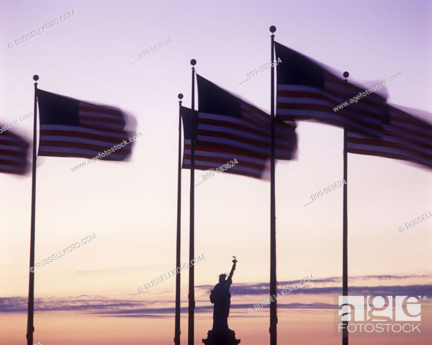 Stock Photo: United States Flags & Statue Of Liberty, New York, Usa.
