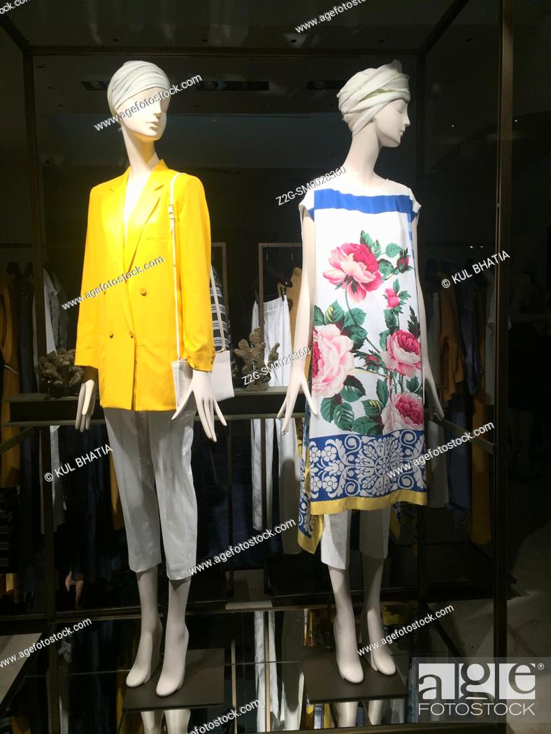 Stock Photo: Two mannequins model the latest summer styles in a store window, Siracusa, Sicily.