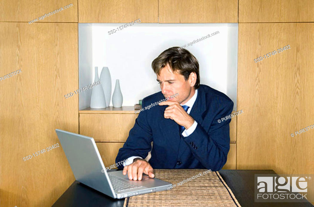 Stock Photo: Close-up of a businessman using a laptop.