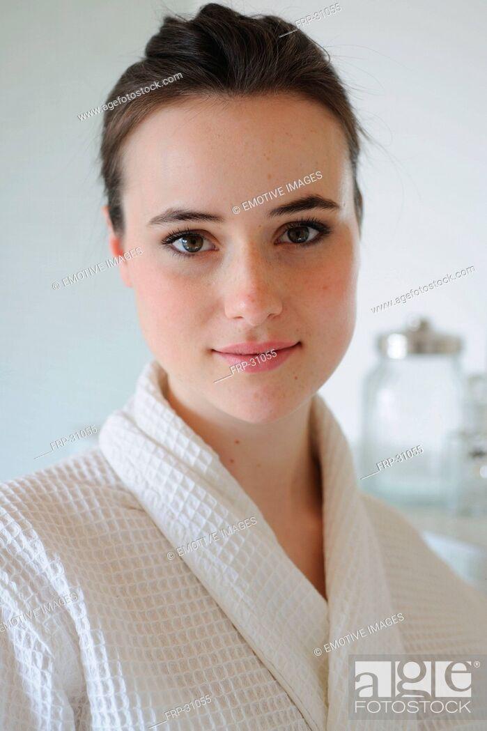 Stock Photo: Young woman in bathrobe.
