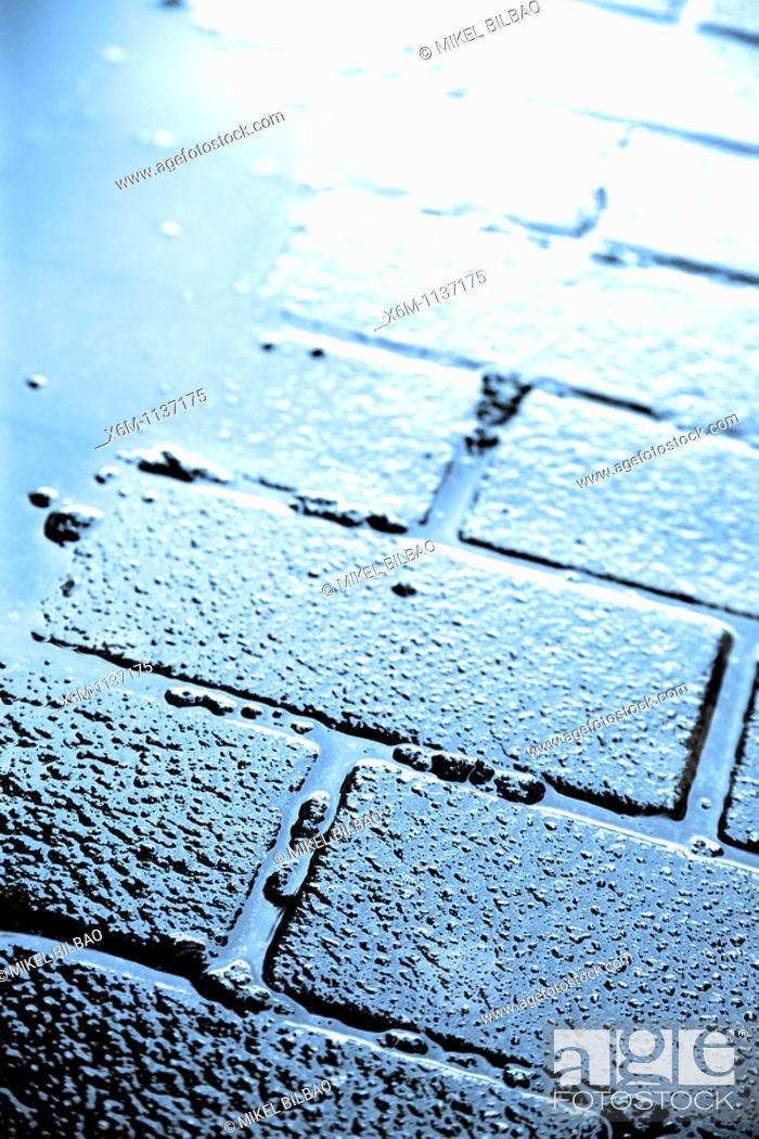 Stock Photo: wet sidewalk.
