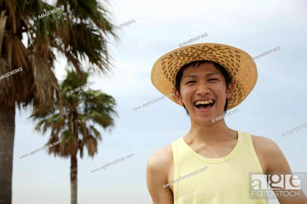 Stock Photo: Portrait of a young man laughing.