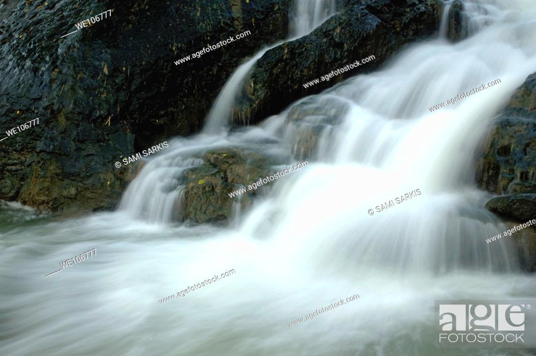 Stock Photo: Waterfall cascading into Li Jiang River, Yangshuo, Guangxi, China.