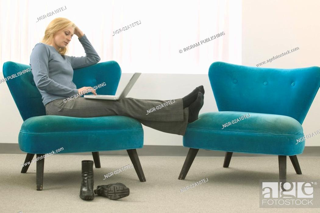 Stock Photo: Woman Working with Laptop.